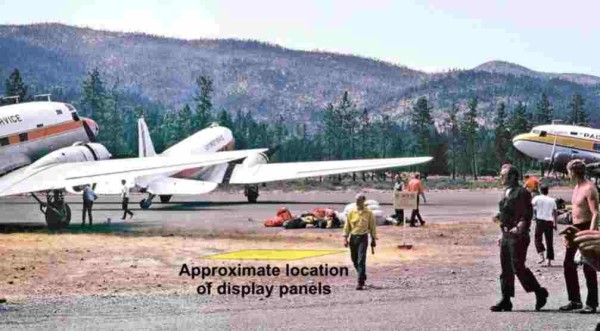 Photo showing three DC-3 aircraft on the tarmac during a fire bust (a time when a large number of fires start after a lightning storm). Siskiyou Smokejumper Museum, Cave Junction, Oregon