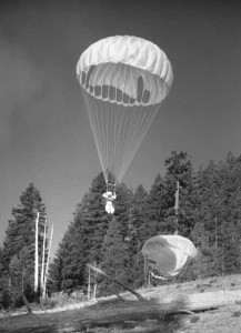 Photo of smokejumper landing in the forest. Siskiyou Smokiejumper Base Museum, Cave Junction, Oregon. Photo by Doug Beck