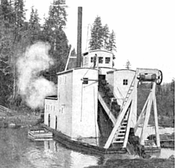 Photo of the Josephine gold dredge operating in pond, southwest Oregon
