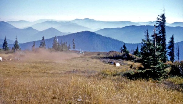 Photo of smokejumper airplane taking off from the Fish Hook Peak airstrip, southwest Oregon