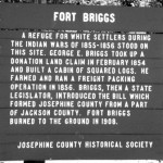 Photo of the Fort Briggs historic marker showing text. Oregon Caves Road Guide, Cave Junction, Oregon