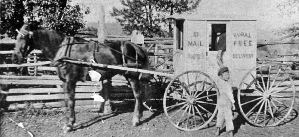 Photo of a mail wagon delivering mail to a farm on Holland Loop Road, Cave Junction, Oregon