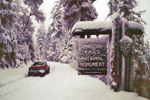 Oregon Caves National Monument entrance sign (elevation 4,000ft) after snow storm, Cave Junction, Oregon