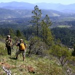 Photo showing hikers on Woodcock Mountain overlooking Cave Junction, southwest Oregon