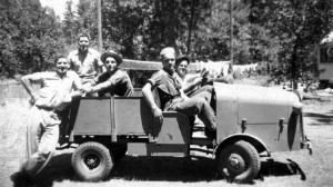 Photo taken in 1944 shows some of the smokejumper crew sitting in the narrow gauge truck, Cave Junction, southwest Oregon