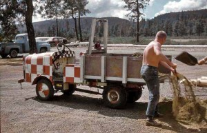 Photo showing the narrow gauge truck being used for maintenance at the Siskiyou Smokejumper Base, Illinois Valley Airport, Cave Junction, Oregon